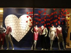 BANANA REPUBLIC | This nostalgic paper hearts display makes us think of the homemade cards of our childhood.  Fill your windows with red & white merchandise & surround them oodles of paper hearts for a classic look. #ValentinesDay #StoreDisplay #VisualMerchandising