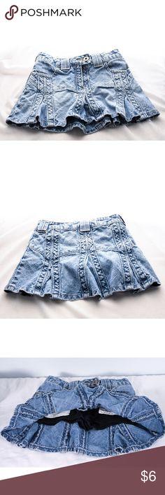 Girls Denim Skort Cute denim pleated Skort. Snap and zip closure. Attached shorts underneath are a comfy cotton. Girls size 4. Bottoms Skorts