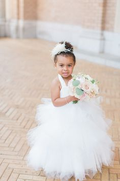 The most adorably stylish flower girl! http://www.stylemepretty.com/new-jersey-weddings/2016/08/29/stylish-black-tie-ballroom-wedding/ Photography: Dyanna LaMora - http://www.dyannalamora.com/