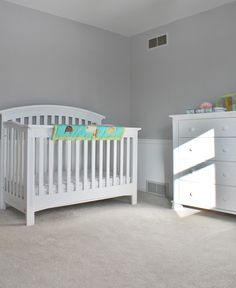 Baby's room.  Paint: Sherwin Williams, Light French Grey (top).  Sherwin Williams, Pure White (bottom).