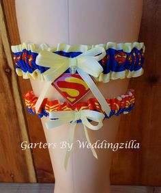 Are you marrying a superhero?  Superman and Wonder Woman unite for eternity in this superhero #wedding garter set.  I used yellow satin and banded the center with superman.    I added an enameled Superman... #bride #superherowedding #superman #wonderwoman #weddinggarter #geekery