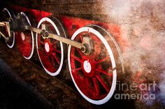 Steam And Iron - Keeping In Steam. View of an old steam engine wheels of red color, covered with a cloud of steam. The train is ready for departure. The great adventure is to begin in a few minutes. Play of black, red, white and brown colors. Tribute to the age of steam. This #photo can be used as a #greeting #card, or a #poster, or a #canvas to #decorate a #home, or an #office.