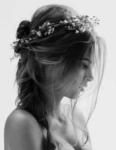 Feminine floral headband teamed with a messy hair style - boudoir vs. grunge.