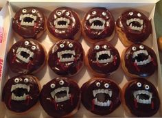 """Easy, Cute, Halloween Treat for my son's 4th Grade Class Halloween Party! Donuts with vampire teeth, candy eyes and a little """"blood"""" red icing added!"""