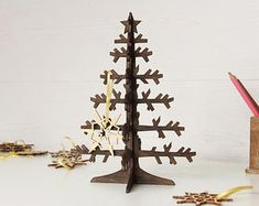 Check out our wooden tree selection for the very best in unique or custom, handmade pieces from our pretend play shops. Metal Christmas Tree, Small Christmas Trees, Christmas Gifts, Holiday, Christmas Decorations, Wooden Stars, Wooden Tree, Apartment Office, Cute Presents