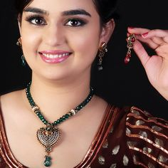 Kaneesha Green Necklace Set Add A Touch Of Green To Your Attire, Courtesy This Jewellery Set From Kaneesha, This Jewellery Set Has A Very Boho Look And Goes Well With Fusion Wear.  #FashionJewelryIndia #CostumeJewelryIndia