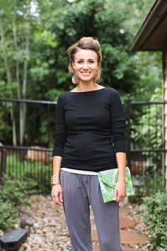 half up pixie, black tee, clutch, jogger pants, wedges, leather earrings
