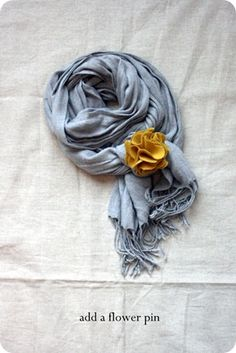 Make the pin and pin it to a scarf... also links to a how to for wrapping the scarf