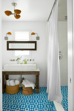 Beach bungalow bathroom with bright aqua pattern floor tile