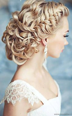 Get inspired: A dramatic braided wedding hairstyle that brings out the bride's delicate profile and complements the lace on her dress. Love this!