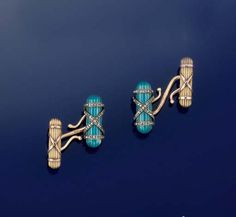 A PAIR OF GOLD, ENAMEL AND DIAMOND CUFFLINKS, BY FABERGÉ  Designed as a baton of fasces design decorated with blue enamel on silver and overlaid with rose-cut diamond cross-over strap motifs, to a smaller two colour gold baton link of similar design with S link connection between, circa 1900, Russian assay marks Stamped KF in Cyrillic with scratched inventory number 2355 (2) - Sold for $33,247