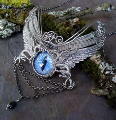 I think I'm in love!!!  --> Gothic Steampunk Griffin Dragon Cat Evil Eye by twistedsisterarts