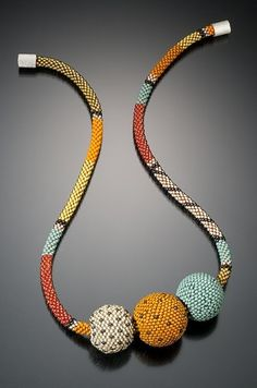 Lynne Sausele is a freelance artist who creates beautiful jewelry and is also a painter. These necklaces caught my eye and I absolutel...