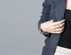 Silver Nugget Ring and silver bangles by Forma. Linen jacket by Cole Hands