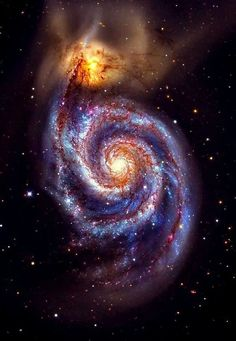 Kewl thing about this is the huge spiral galaxy is absorbing a small nebula that happened to stray too close. It'll take millions of years, but eventually, the galaxy will consume every bit of the dust and gas. It'll make new stars, and there may be some cosmic collisions.