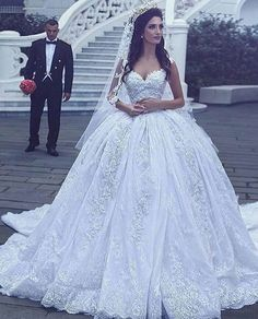 Traditional wedding dresses like this ball gown style can be made to order for brides according to all of their preferences. We can make replicas of any haute couture wedding dresses that you love from the internet for a much lower price. Contact us for details at www.dariuscordell.com