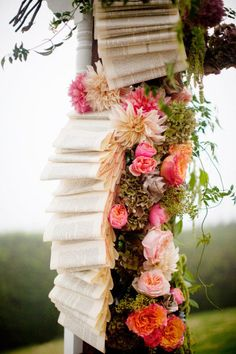 overflowing books wedding decor... two writers... cute idea! I have a feeling lotsa trees will be sacrificed for this wedding... hahaha. But yeah, back to this! so pweets, with the flowers <3