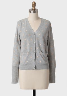 Simple Wish Buttoned Sweater In Gray 46.99 at shopruche.com. Adorned with pale peach polka dots, this cotton-blend, heather-gray sweater features cream and brass-toned front button closures. Finished with front besom pockets, a V-cut neckline, and ribbed hems.40% Polyester, 60% Cotton, Imported,...