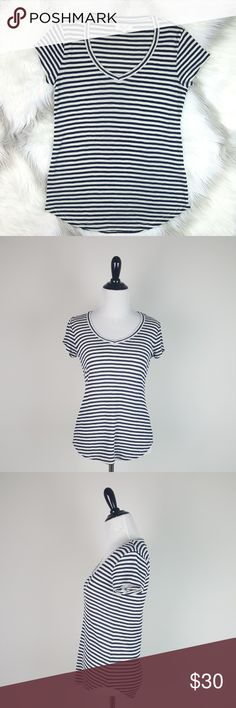 """Madewell Navy Striped V-Neck Short Sleeve Shirt Madewell Navy Striped V-Neck Short Sleeve Shirt. Colors: Navy and Cream Size: S Approximate Measurements Laying Flat: Length- 23 1/2"""" Underarm to Underarm- 15 1/4"""" 51% Polyester, 49% Viscose Bundle and Save! Madewell Tops Tees - Short Sleeve"""