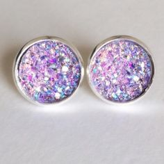 """3 for 15🎀 light purple Flat Druzy style earrings PLEASE DO NOT BUY THIS LISTING.💕Please comment """"Bundle"""" under the items you'd like so I can make a listing. 😊 Handmade by me Drusy style 1/2 inch 12mm earrings in silver plated frame. Silver backs. 3 pairs for $15. Minimum charge $15. Additional pairs $5. Price firm. Can mix/match any 3 for 15 items. Each piece varies slightly in shape. Glitter/ sea salt texture. Bead often has tiny gap when placed on setting. Made of acrylic resin. 🚫Add…"""