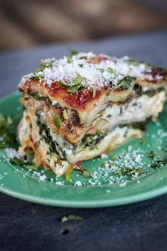4 cheese spinach and mushroom lasagna. Super cheesy and meaty while still being vegetarian! Plus super easy to make for a crowd - a staple at my family gatherings!
