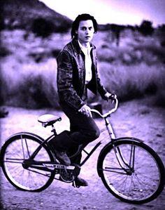 Johnny Depp.  He still looks cool, even on a girls bike!