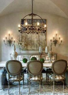 buffet and sconces on wall, chandelier, artwork, upholstered chairs