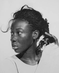 "Nigerian artist Arinze Stanley creates incredibly realistic large-scale portraits using graphite and charcoal pencils on paper.  ""Spending upwards of 200 hours on an artwork, Stanley agonizes over the most minute details of each piece to painstakingly capture reflections of light, droplets of sweat, or tangles of hair.  Where some hyperrealistic artists lean towards idealized perfection, Stanley instead focuses on pure realism, infusing portraits with a raw sense of emotion and drama. Th..."
