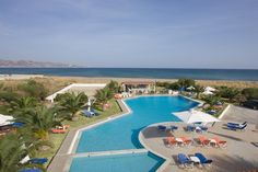 Akti Corali Hotel || Just 3 km from Heraklion and only 10 metres from Amoudara sandy beach, Akti Corali Hotel features a large outdoor pool with sun beds and umbrellas. All rooms are air conditioned.
