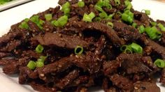 Marinate beef steaks in this a sweet sauce of soy, sugar, garlic, and sesame and grill.  Roll up in red leaf lettuce with rice and hot pepper paste for a real Korean-style treat.