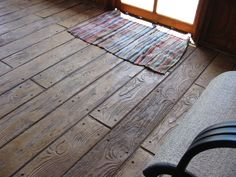 Stamped concrete that looks like wood -- love it for the tack room.  Brick for the rest of the barn.  =)