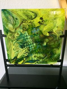 Something new out of my studio. This technique is called a screen melt and involves placing pieces of glass onto a stainless steel screen, taking it up to about 1650 degrees Fahrenheit, and then letting it melt through the screen into a square stainless steel form. Love the colors and the way the glass decided to move.