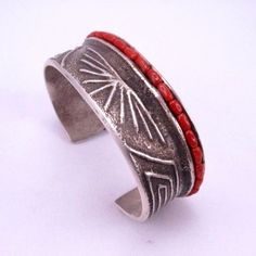 Ira Custer ~ Navajo ~ Tufa Cast Sterling Silver Bracelet W/ Coral. Love this!