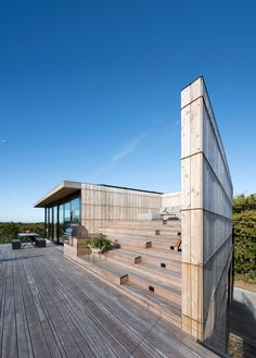 Inspired by the architecture of a century-old Life-Saving Station nearby, Bates Masi Architects has infused local maritime history into the design of this residence in Amagansett, New York. The single family home was designed for a West Coast-based y. Residential Architecture, Art And Architecture, Architecture Details, Beam Structure, Built In Bbq, Raised Planter, Modern Architects, Amazing Buildings, Modern Landscaping