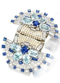 An Art Deco Natural Pearl, Sapphire and Diamond Cuff, by Cartier, circa 1930. #Cartier #ArtDeco #cuff #bangle #bracelet