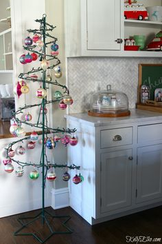 Love this wire Christmas tree filled with vintage Shiny Brite ornaments kellyelko.com