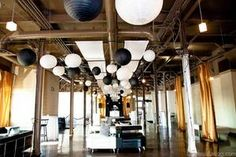 Black and white paper lanterns make lovely modern wedding decorations especially for an industry style loft wedding venue. | Pierpont Place in Salt Lake City, UT