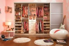 Eclectic Closet with Ikea Komplement Glass Shelf, White, Whimsical, Custom closet storage, Hardwood floors, Closet system