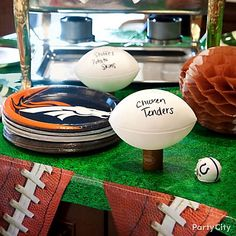 Turn footballs into cool food markers to let guests know what's what in your party food lineup!