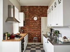 exposed bricks, white furniture (via Stadshem)