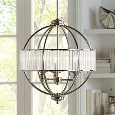 Clear acrylic rods add sparkle to this chic, orb-shaped pendant light from the Possini Euro Design lighting collection.