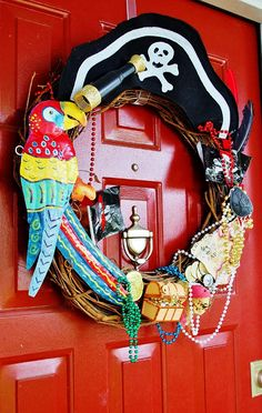 An Affordable DIY Gasparilla Wreath - Miss Frugal Fancy Pants Pirate Halloween, Pirate Day, Pirate Birthday, Pirate Theme, Pirate Wreath, Pirate Treasure, 4th Birthday Parties, Fancy Pants, How To Make Wreaths