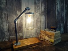 Mason Jar Desk Lamp - Desk Lamps -  Mason jar desk lamp made from local Missouri and Illinois vintage reclaimed barn wood. Galvanized piping delivers an excellent industrial lighting look that goes great …    Read More »  #Bedroomdecor #Bedside #Desklamp #Diylighting #Farm #Farmhousedecor #Handmadelighting #Industrial #Lamp #Lighting #Lightingdesign #Masonjars #Metallic #Recycle #Rusticlighting #Vintagelighting #Woodlamp #Woodworking