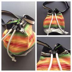 Descripción: Bolso mochila  Color: naranja, verde, amarillo  Medidas: 40cmx35cm Material: algodón y cuero sintético