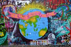 """Lennon Wall in Prague. I've heard some people say Prague is """"dirty"""" and """"covered with graffiti."""" Prague is spectacularly beautiful, in an ages-old way. To say it's dirty is to miss the nuances of that, as some miss the beauty of antiques and marble statues with the noses broken off. The graffiti is actually one of the many thousands of things I loved about Prague. Graffiti isn't necessarily a sign of urban decay there as it's typically assumed in the USA, & more an expression of freedom."""