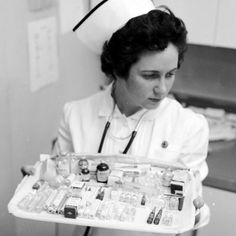 25 Vintage Pictures That Prove Nurses Have Always Been Badass. A nurse carries some of the great variety of drugs that are kept within easy reach of the recovery room at the New York Polyclinic Hospital in 1956.
