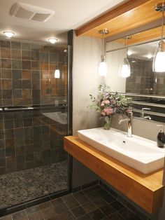 Bathroom Sinks and Vanities from Bath Crashers : love the tile, to rock flooring, to tile through the shower door - and love the sink Watch Bath Crashers online now         Find Bathroom Ideas From DIYnetwork.com