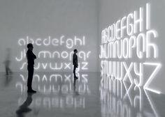 BIG designs lettered lighting structures for Artemide