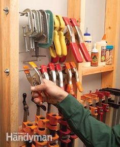 Hang bar clamps between studs Clamps scattered and hard to find when you need them most? Heres a way to keep them in one spot. Hang bar clamps on horizontal scraps of 2x4 screwed between open wall studs. Add another board or two for glue bottles, dowels and biscuits
