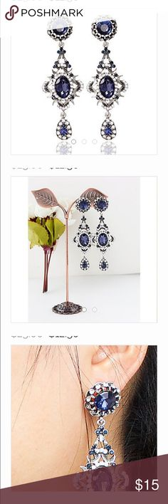 """Sapphire Silver Chandelier Earrings Pierced NWT These earrings are full of sparkle.  They are platinum plated and feature AAA quality cubic Zirconia's in clear and blue sapphire.  Pierced ears approximately 2"""" long. Curvy Couture Jewelry Earrings"""